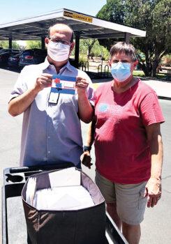 Club member Pat Serveiss with Jason, a hospital volunteer at the Tucson–Southern Arizona Veterans Hospital