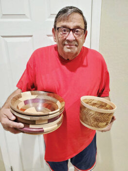 Tom Bruno with two of his bowls; bowl at left