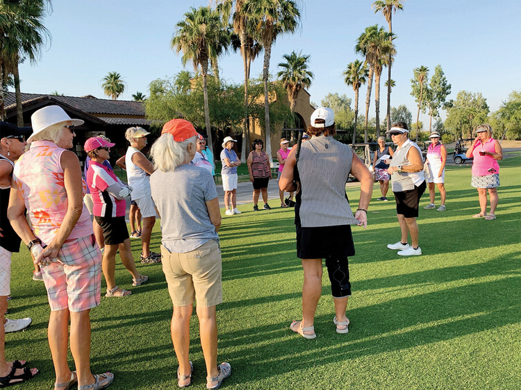 """Kathy Holwick delivering preround instructions; """"Hydrate, hydrate, hydrate!"""""""