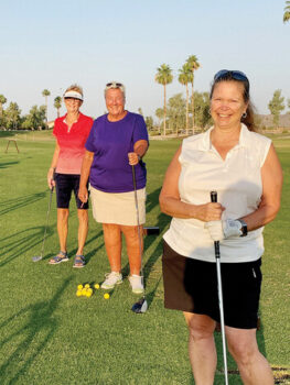 Jeanie Bales (back), Jane Everett, and Becky Sheffler are on the practice range at 6 a.m. Heat doesn't scare them!