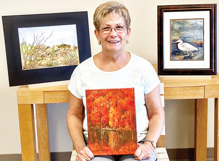 Paula Lambert with some of her artistic creations.
